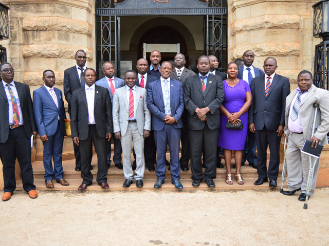 Members of the New MUASA Executive pose for a group photo with the Vice Chancellor-Prof. Barnabas Nawangwe (C) and Prof. William Bazeyo (3rd L) after the swearing in ceremony on 15th January 2018, Makerere University, Kampala Uganda