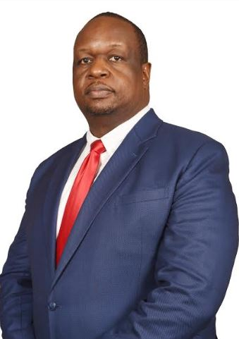 Absa Bank Uganda director Mr Mumba Kalifungwa