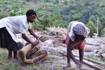 A woman and her daughter search among the debris for anything they can salvage