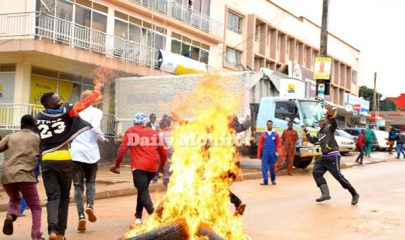 NUP protestants being chased by security in Kampala - Photo by Daily Monitor