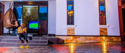 cyclonetimes fans are inspired as Gravity Omutujju Parades his Newly Constructed House