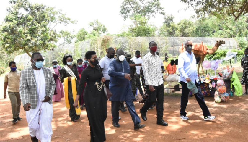 UWEC director James Musinguzi taking the Kyabazinga and his officials for a tour within the zoo